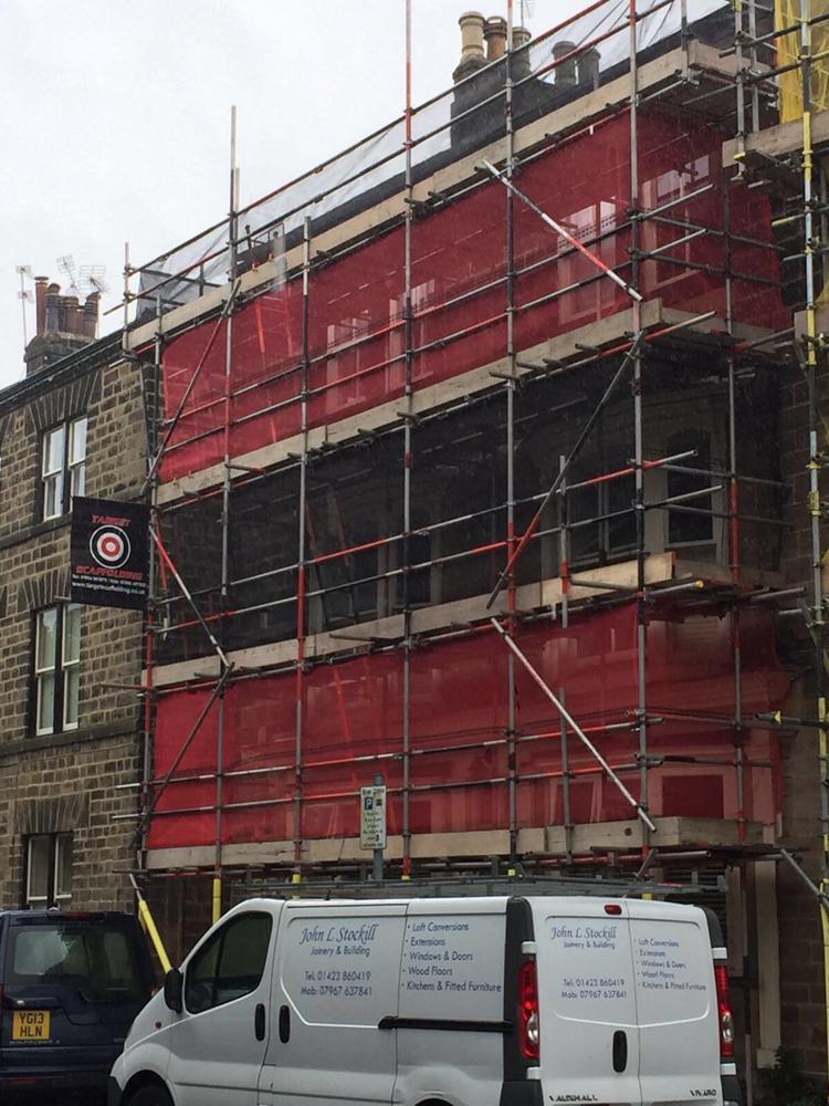 scaffolding on a building facia street