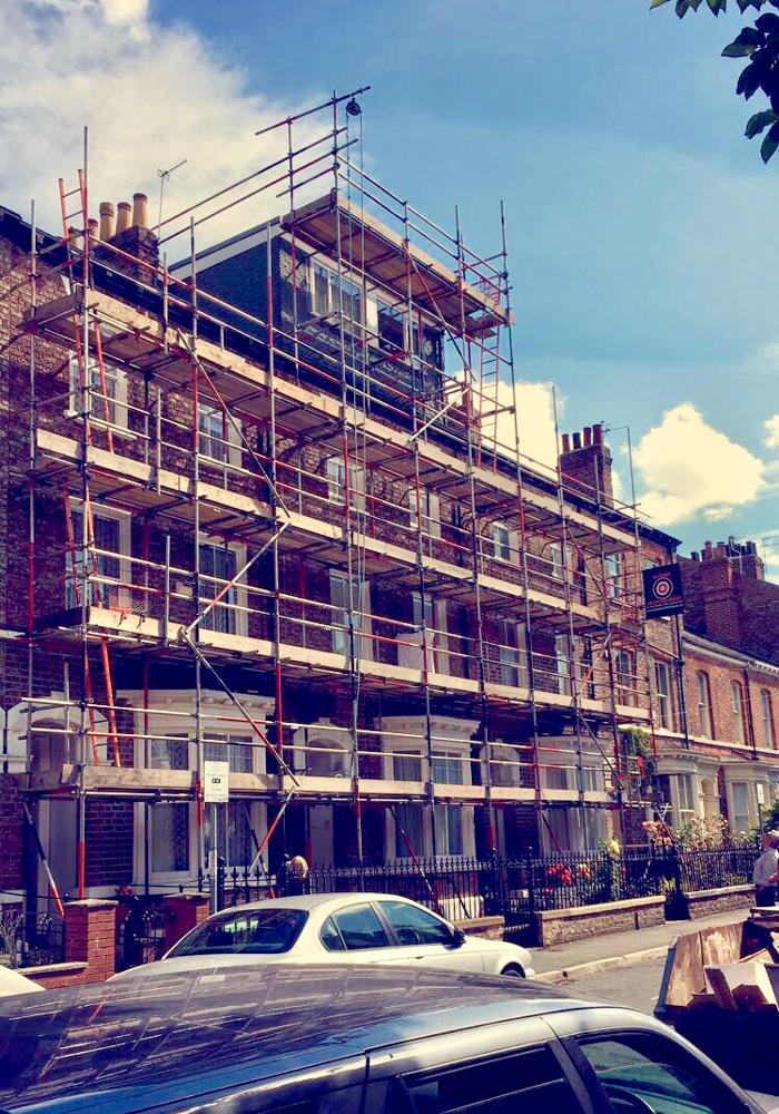scaffolders working on a terraced street in york